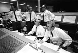 Traditional mission control dress codes require a white shirt, black pants, black tie, and looking as much like Less Nessman as possible.