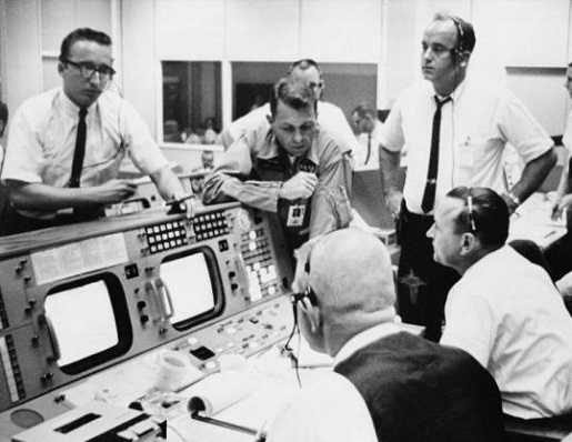 "'Houston, we have a problem."" Traditional mission control dress codes require a white shirt, black pants, black tie, and looking as much like Less Nessman as possible."